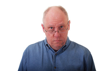 Older Balding Man in Blue Shirt Looking Over Glasses