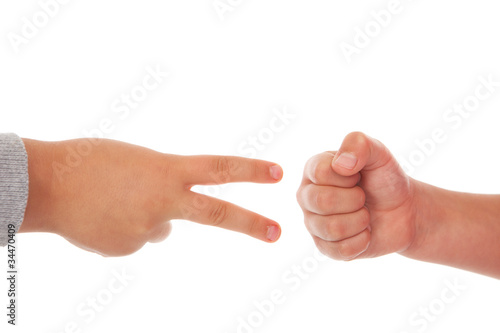 two children playing rock paper scissors