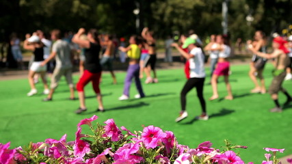 a group of people engaged in fitness outdoors