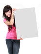 happy young woman holding a blank board against white bacground