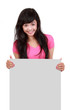 happy young woman holding on blank board against white bacKgroun