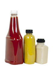 Ketchup, Mustard and Horseradish in Bottles; Angle View