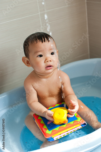 7 month old Asian baby girl enjoying her bath time