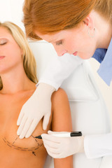 Plastic surgery doctor draw line patient breast