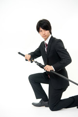 a businessman with samurai sword