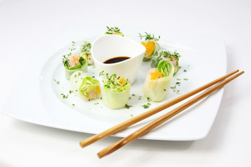Salad sushi with soy sauce