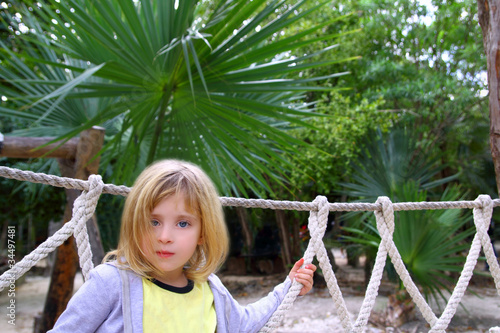 adventure little girl on jungle park rope bridge