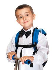 Elementary student boy with backpack and scooter