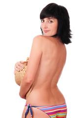 Beautiful brunette woman in topless bikini with hat in hand