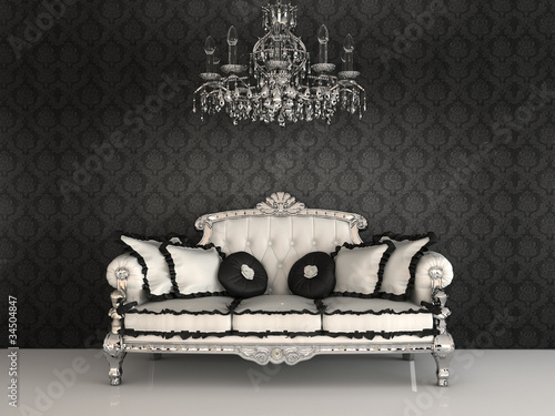 Royal sofa with pillows and chandelier in luxurious interior wit
