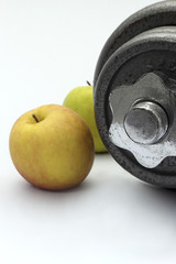 Dumbbell and apple