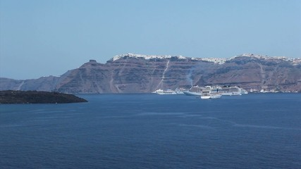 Santorini island view from ship with cruiseships