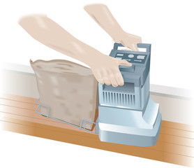 A hand held floor sander