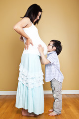Pregnant Asian mother and her son
