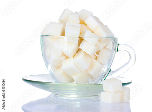 refined sugar in glass cup isolated on white