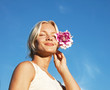 happy woman holding a flower