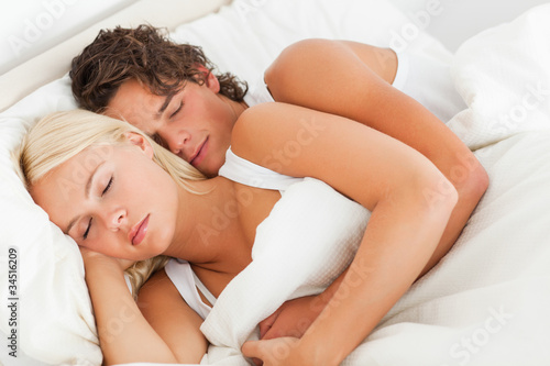 Quiet couple hugging while sleeping