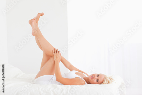 Beautiful woman with the legs up