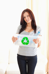 Woman showing recycling bin