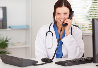 Female doctor telephoning