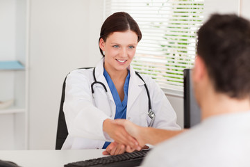 Female doctor greeting a patient