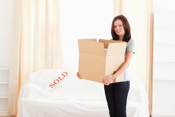 Woman holding full cardboard