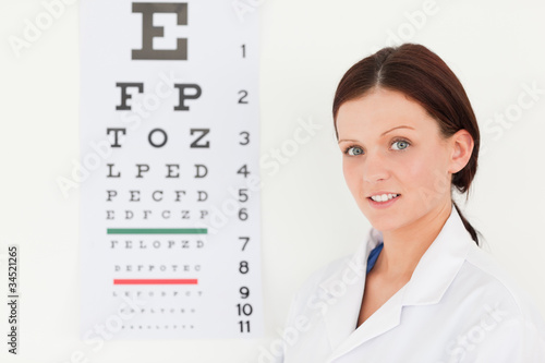 Female optician with eye test