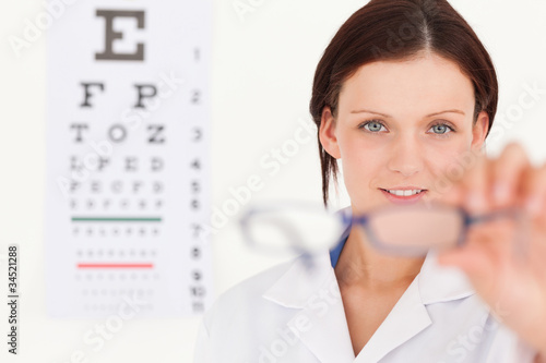 Female optician showing glasses