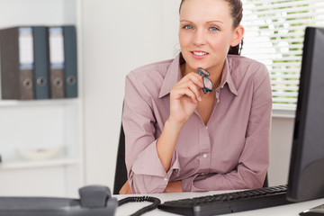 Businesswoman with glasses in office