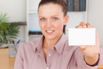 Beautiful businesswoman holding a card
