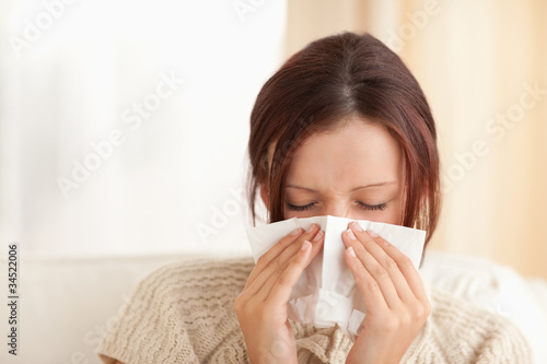 Sneezing cute woman