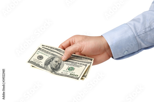 man's hand holding money
