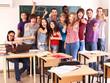 Student in classroom near blackboard.