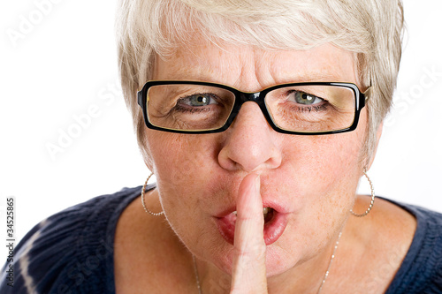 Mature woman shushing