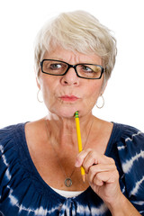 Elderly woman thinking hard with a pencil