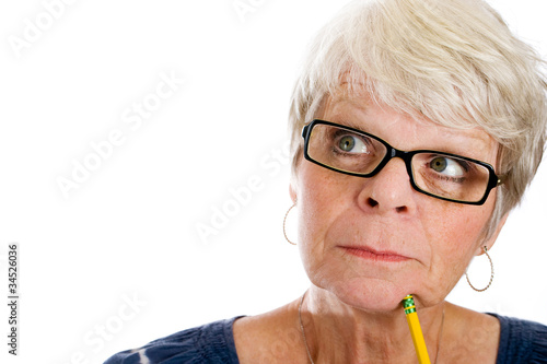 mature gray haired lady forgetting something
