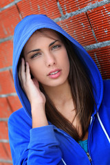 Portrait of teenager with blue sweater