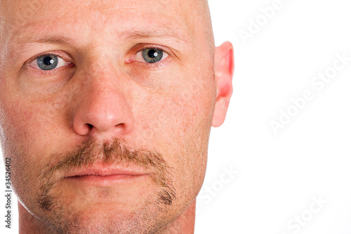 Serious man with a mustache