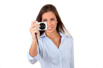 Portrait of beautiful woman using compact digital camera