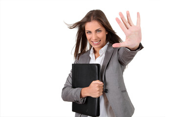 Portrait of young businesswoman showing thumb up