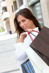 Beautiful smiling woman holding shopping bags