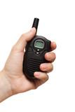 Hand holding walkie-talkie radio poster