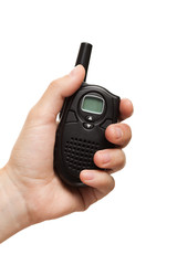 Hand holding walkie-talkie radio