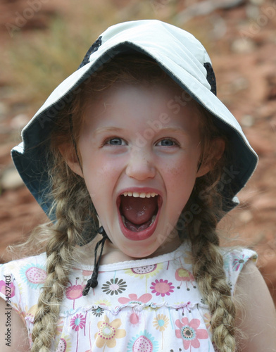 A Little Screaming Girl in a White Hat