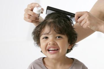 Traitement des poux chez un enfant