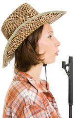 Cowboy woman with a gun on a white background.