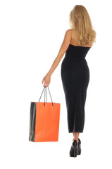 beautiful woman with orange shopping bags