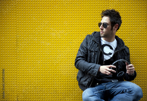 Man against a yellow wall in modern style