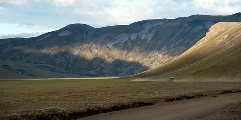 two 4wd vehicles on the dusty roads to Landmannalaugar, Iceland.