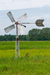 Old Dutch windmill in the field